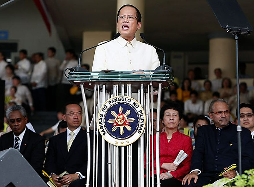President Benigno Aquino III delivers his inaugural address shortly after taking his oath as the Philippines' 15th President during inaugural ceremony Wednesday June 30, 2010 in Manila, Philippines.  Aquino was sworn in Wednesday as the Philippines' 15th president, leading a Southeast Asian nation his late parents helped liberate from dictatorship and which he promises to deliver from poverty and pervasive corruption. (AP Photo/Bullit Marquez)
