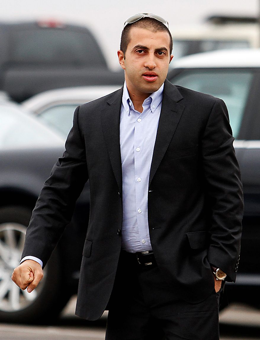 Mosab Hassan Yousef walks into his deportation hearing held at the immigration detention center in San Diego Wednesday, June 30, 2010.  Yousef says he will be killed if he is deported from the United States to the West Bank. The oldest son of one of Hamas' founders, he was an Israeli spy for a decade, and he abandoned Islam for Christianity, further marking him a traitor.   (AP Photo/Denis Poroy)