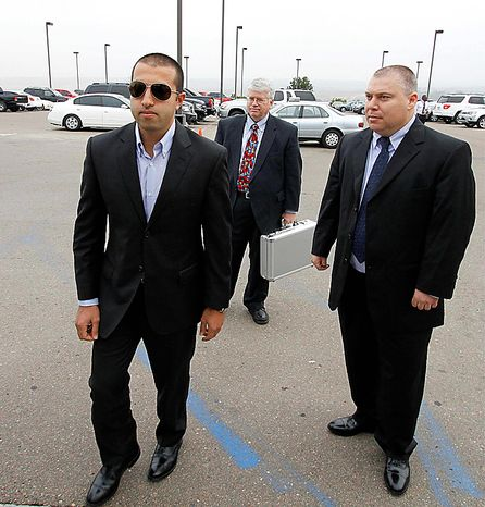 Mosab Hassan Yousef, left,, walks into his deportation hearing with his attorney Steven Seick, center, and former Israeli security service agent Gonen Ben-Itzhak, right, at the immigration detention center in San Diego Wednesday, June 30, 2010.  Yousef says he will be killed if he is deported from the United States to the West Bank. The oldest son of one of Hamas' founders, he was an Israeli spy for a decade, and he abandoned Islam for Christianity, further marking him a traitor.   (AP Photo/Denis Poroy)