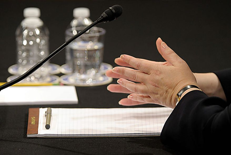 The hands of Supreme Court nominee Elena Kagan move as she testifies on Capitol Hill in Washington, Wednesday, June 30, 2010, before the Senate Judiciary Committee. (AP Photo/Susan Walsh)
