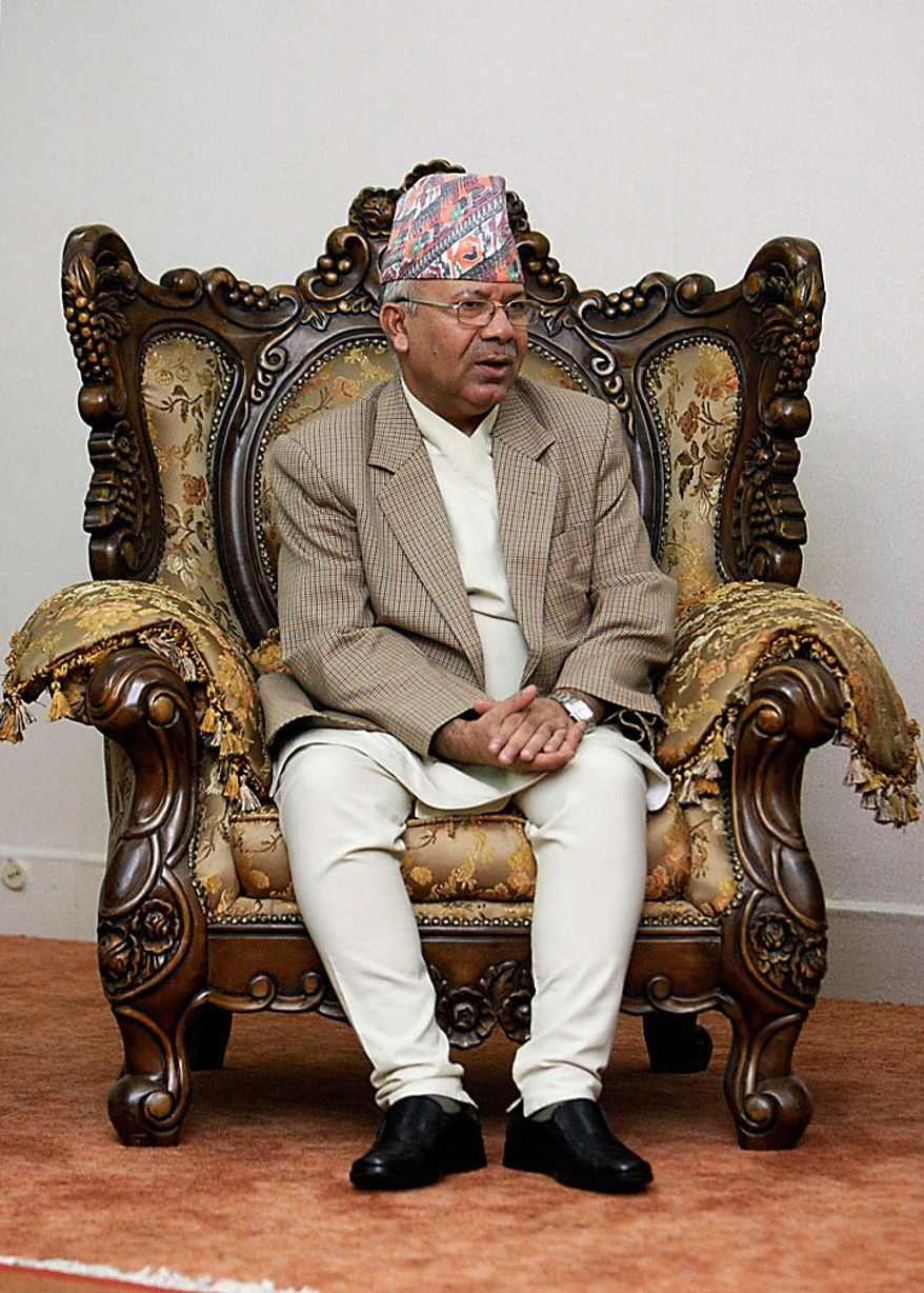 Nepal's Prime Minister Madhav Kumar Nepal waits to meet Nepal's President Ram Baran Yadav after announcing his resignation in Katmandu, Nepal, on Wednesday, June 30, 2010. Mr. Nepal announced his resignation Wednesday, bowing to pressure from opposition Maoists who have been demanding his oust in parliament and on the streets. (AP Photo/Gemunu Amarasinghe)