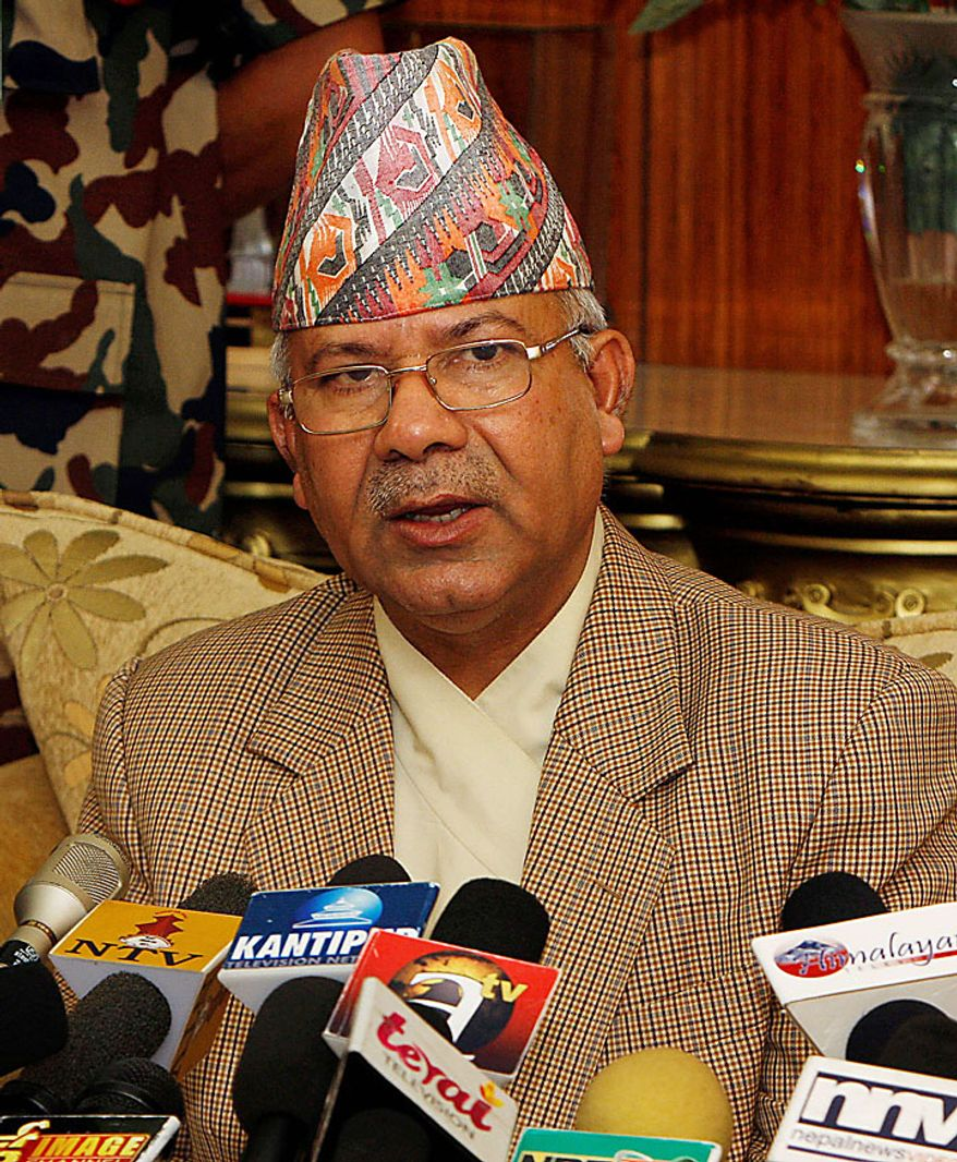 Nepali Prime Minister Madhav Kumar Nepal speaks during a televised speech at his official residence in Katmandu, Nepal, on Wednesday, June 30, 2010. Mr. Nepal announced his resignation, bowing to pressure from opposition Maoists who have been demanding his ouster in parliament and on the streets. (AP Photo/Binod Joshi)