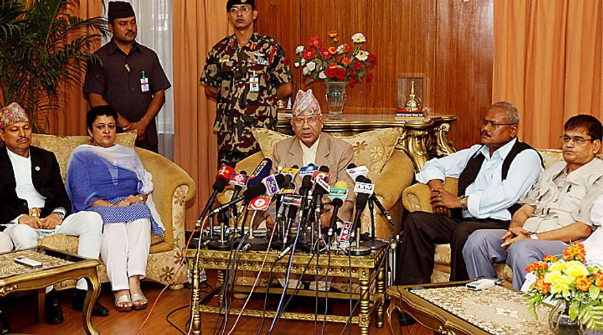 Nepali Prime Minister Madhav Kumar Nepal, center, speaks during a televised speech at his official residence in Katmandu, Nepal, on Wednesday, June 30, 2010. Mr. Nepal announced his resignation, bowing to pressure from opposition Maoists who have been demanding his ouster in parliament and on the streets. (AP Photo/Binod Joshi)