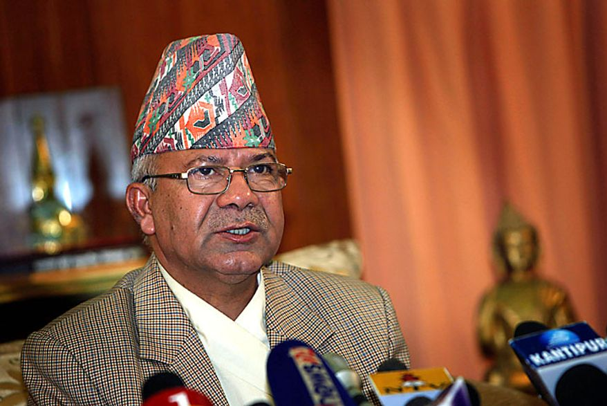 Nepal's Prime Minister Madhav Kumar Nepal speaks during a televised speech announcing his resignation at his official residence in Katmandu, Nepal, on Wednesday, June 30, 2010. Mr. Nepal announced his resignation Wednesday, bowing to pressure from opposition Maoists who have been demanding his ouster in parliament and on the streets. (AP Photo/Gemunu Amarasinghe)