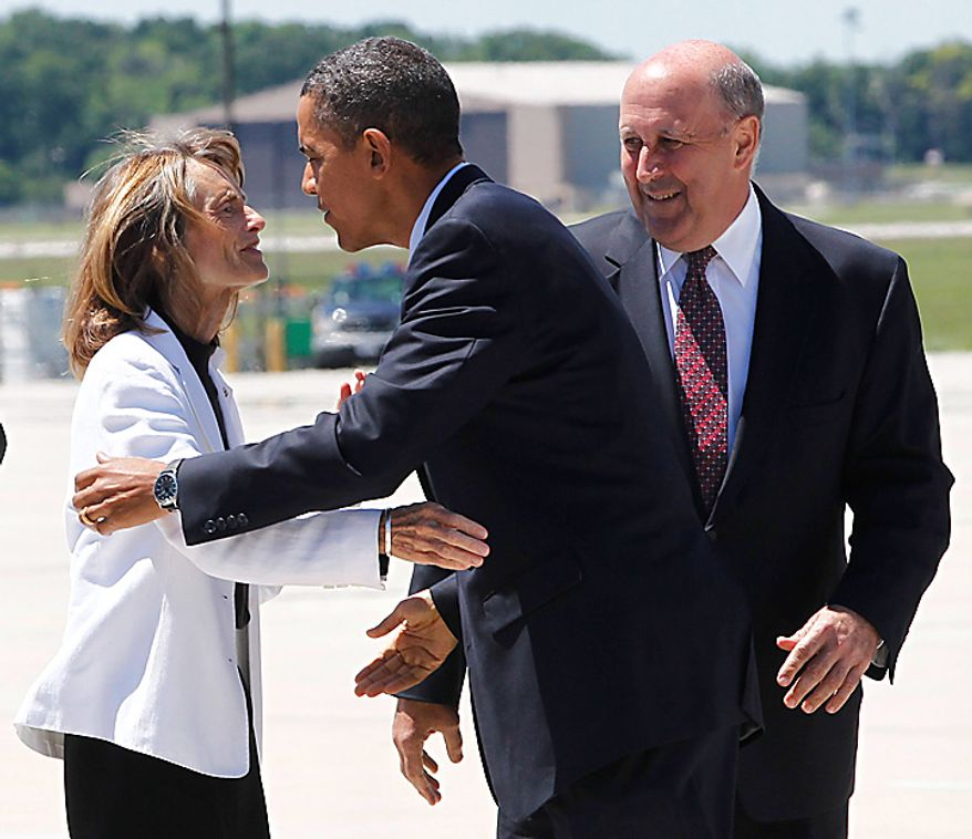 President Barack Obama is greeted by Wisconsin Gov. Jim Doyle and his wife Jessica as he arrives at General Mitchell International Airport in Milwaukee, Wis., Wednesday, June 30, 2010, prior to traveling to Racine, Wis., to hold a town-hall style event on the economy. (AP Photo/Charles Dharapak)