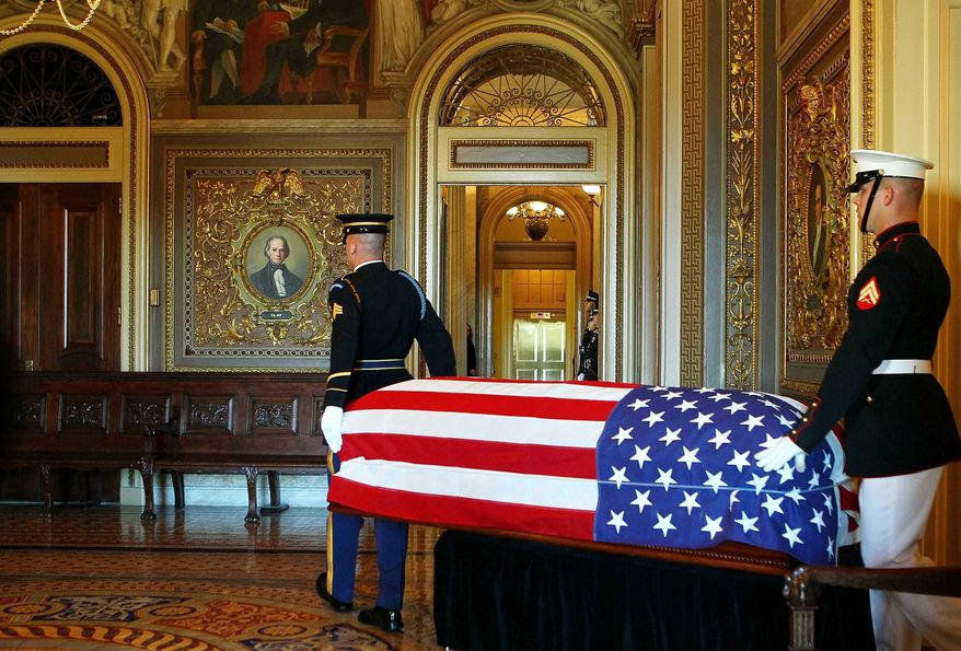 ASSOCIATED PRESS A military honor guard guides Sen. Robert C. Byrd's flag-draped casket through the Senate Reception Room after his body lay in repose in the Senate Chamber on Thursday. The West Virginia lawmaker was famous as the chief upholder of Senate rules and traditions. He was the longest-serving senator in U.S. history.