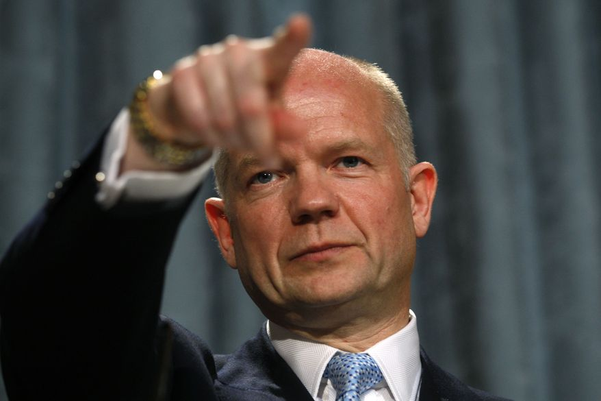 ** FILE ** British Foreign Secretary William Hague delivers his first foreign policy speech at the Foreign and Commonwealth Office in London on Thursday, July 1, 2010. (AP Photo/Sang Tan, Pool)