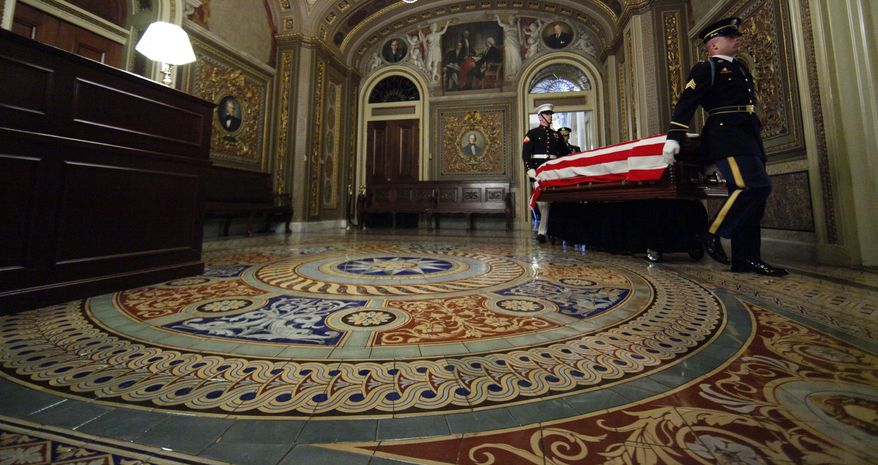 The casket the of late Sen. Robert Byrd, West Virginia Democrat, is carried through the reception room into the Senate Chamber on Capitol Hill in Washington, Thursday July 1, 2010, by a Military District of Washington honor guard. (AP Photo/Alex Brandon, Pool)