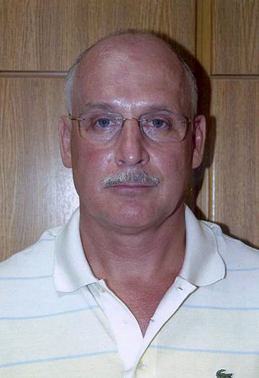 Undated handout photo released from the Cyprus police on Thursday, July 1, 2010, showing alleged Russian spy Christopher Robert Metsos, 54, who they are looking for after he skipped bail and vanished. Mr. Metsos, who identified himself as a Canadian citizen, is wanted in the US on charges that he supplied money to a spy ring that authorities say operated under deep cover in America's suburbs. (AP Photo/Cyprus Police, HO)