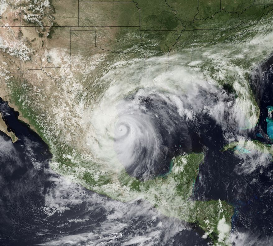 This satellite image provided by NOAA shows Hurricane Alex as it comes ashore Wednesday on a relatively unpopulated stretch of coast in Mexico's northern Tamaulipas state, about 110 miles south of Brownsville, Texas. Alex is moving west near 10 mph. Maximum sustained winds are near 100 mph with higher gusts. Steady weakening is expected as the hurricane moves over land according to forecasters. (Associated Press/NOAA)