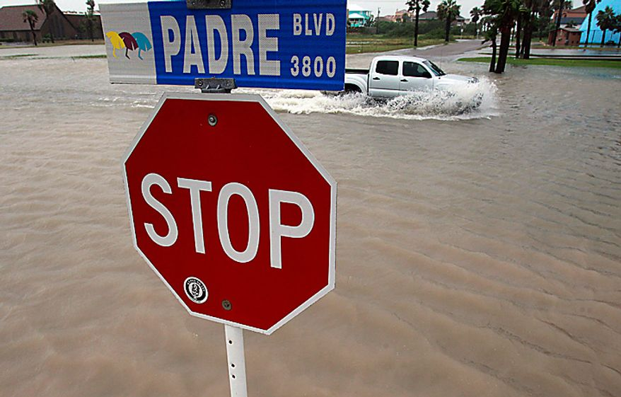 Padre Boulevard floods as the early effects of Hurricane Alex are felt along the Texas coast on Wednesday, June 30, 2010, in South Padre Island, Texas. (AP Photo/Eric Gay)