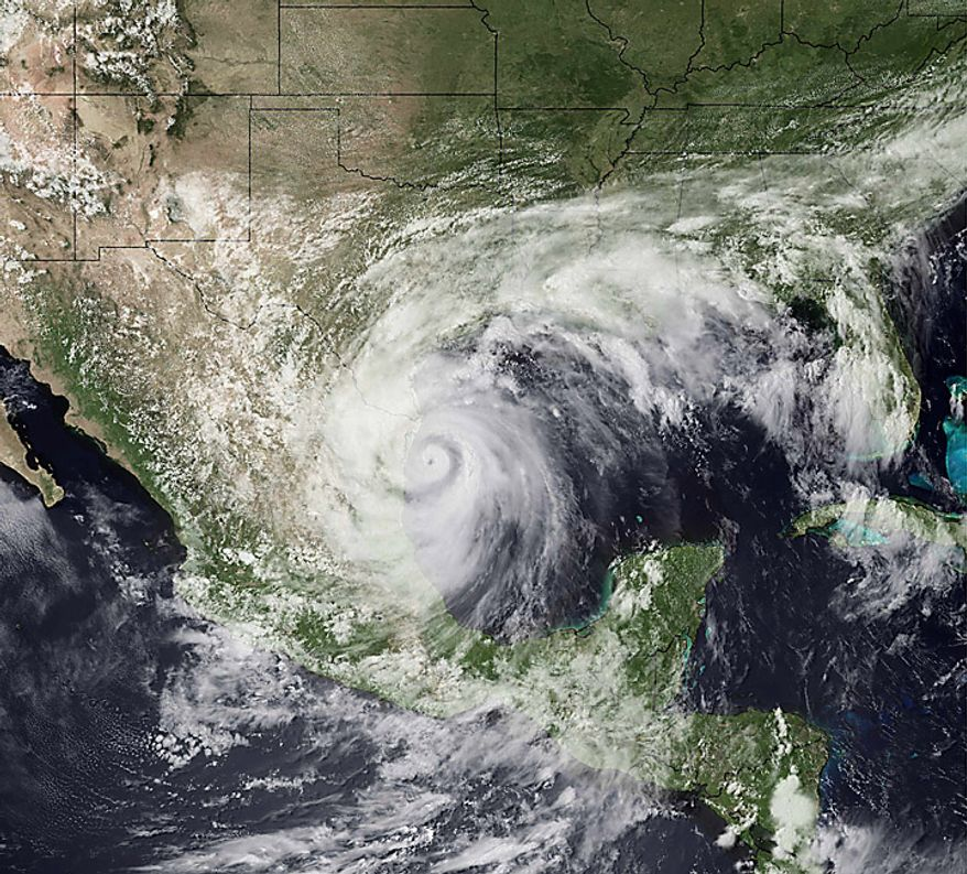 ** FILE ** This satellite image provided by NOAA shows Hurricane Alex as it comes ashore on a relatively unpopulated stretch of coast in Mexico's northern Tamaulipas state about 110 miles south of Brownsville Texas on Wednesday, June 30, 2010. (AP Photo/NOAA)