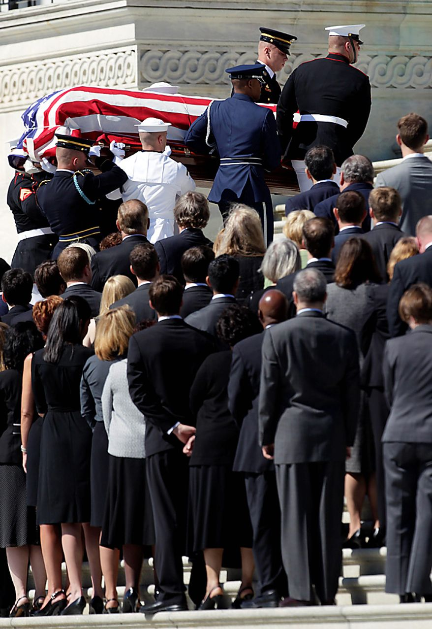 The casket containing the remains of Sen. Robert C. Byrd, West Virginia Democrat, is carried up the Senate steps on Capitol Hill in Washington, Thursday, July 1, 2010. (AP Photo/Carolyn Kaster)