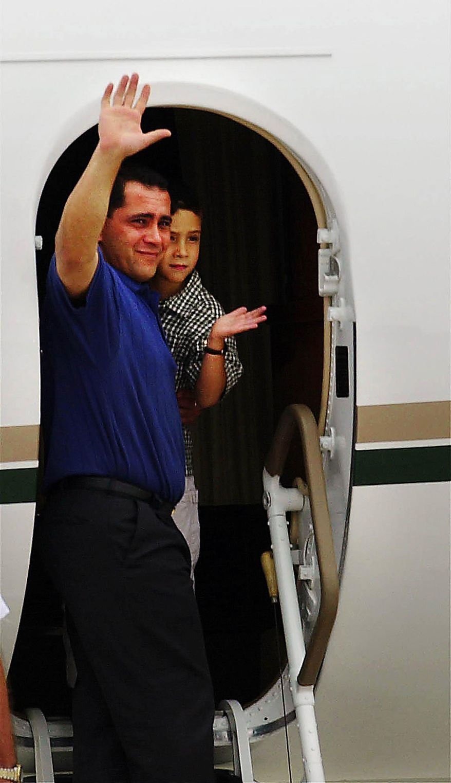 Elian Gonzalez and his father Juan Miguel Gonzalez depart from Dulles International Airport on a charter flight to Havana, Cuba, June 28, 2000. ( Bert V. Goulait / The Washington Times )