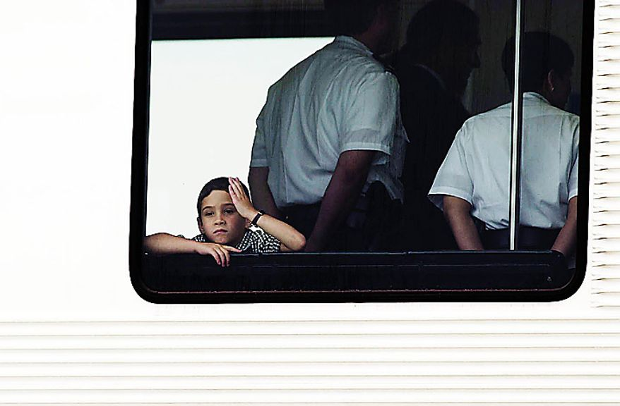 Elian Gonzalez looks a little bored as he waits for his father to finish paperwork with US Customs Officials before they boarded a private jet that took them from  Dulles International Airport  to Havana, Cuba, June 28, 2000. ( J.M. Eddins Jr.  / The Washington Times )