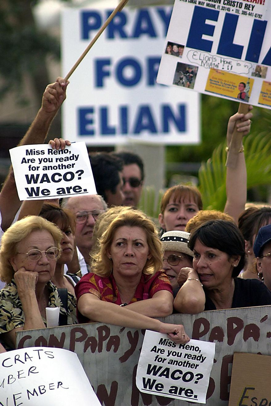 Possible break-thru in the Elian Gonzalez case ... Elian supporters wait near his home Monday afternoon, April 3, 2000. ( Sean Dougherty / The Washington Times )