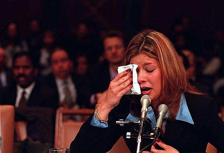 Marisleysis Gonzalez, of Miami, Fla., cousin of Elian Gonzalez, cries as she testifies before the Senate judiciary Committee on Capitol Hill, Wednesday, March 1, 2000. Gonzalez, who is caring for Elian, testified as a tug of war over the boy's fate returned to Congress.  ( Daniel Rosenbaum / The Washington Times )