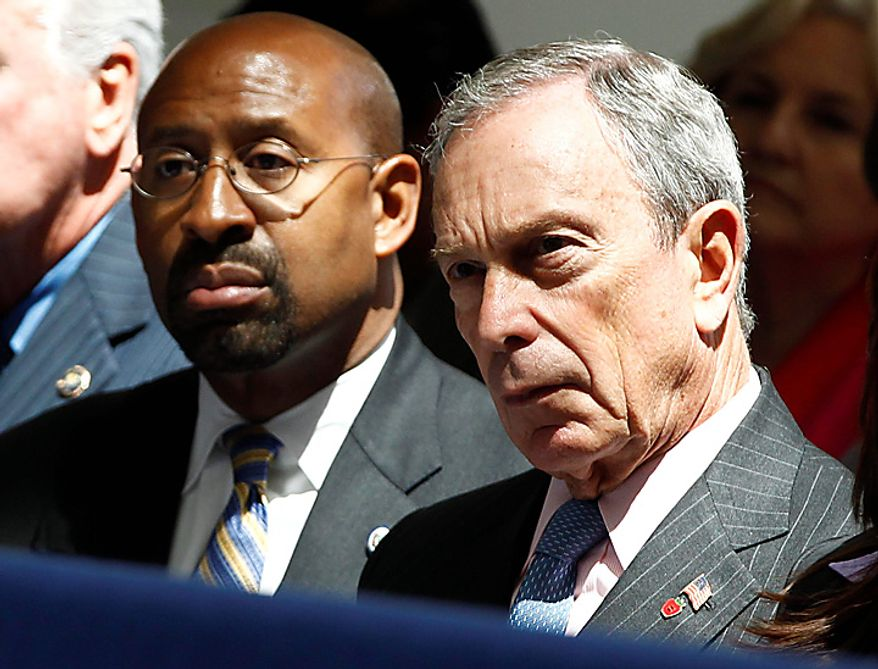 Philadelphia Mayor Michael Nutter, left, and New York City Mayor Michael Bloomberg listen as President Obama speaks about immigration reform, Thursday, July 1, 2010, at American University in Washington. (AP Photo/Charles Dharapak)