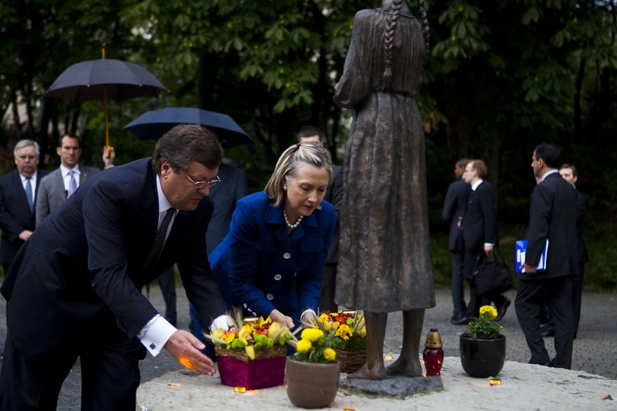 Hillary Clinton and Ukrainian Foreign Minister Kostyantyn Gryshchenko laid flowers at a memorial in Kiev in 2010. Recent news suggests the Ukrainian government and the Democratic National Committee planted seeds to try to stop Donald Trump from winning the presidential election. (Associated Press/File)