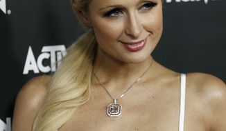 ** FILE ** In this June 14, 2010, file photo, Paris Hilton arrives at the Activision E3 2010 Preview event in Los Angeles. (AP Photo/Matt Sayles, file)