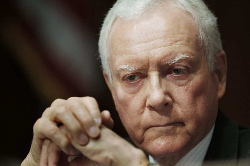 In this April 16, 2010, file photo Senate Judiciary Committee member Sen. Orrin G. Hatch, Utah Republican, listens on Capitol Hill in Washington. On Friday, July 2, Mr. Hatch said he will vote against the confirmation of President Obama's Supreme Court nominee, Elena Kagan. (AP Photo/Charles Dharapak, File)