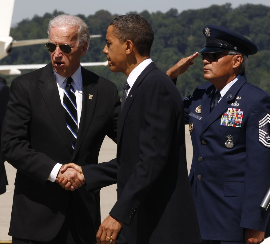 President Obama is greeted by Vice President Joseph R. Biden Jr., upon his arrival at Yeager Airport in Charleston, W.Va., Friday, July 2, 2010, to attend a memorial service for the late Sen. Robert Byrd. (AP Photo/Charles Dharapak)