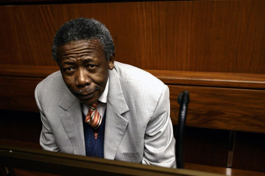 Former South African National Police Commissioner Jackie Selebi, inside the Johannesburg High Court, in Johannesburg Friday, July 2, 2010. He was convicted of corruption Friday after a nation beset by crime heard months of testimony about its top cop going on designer shopping sprees with a convicted drug smuggler. (AP Photo/Werner Beukes, Pool)