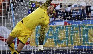 Netherlands goalkeeper Maarten Stekelenburg makes a save during the World Cup quarterfinal soccer match between the Netherlands and Brazil at Nelson Mandela Bay Stadium in Port Elizabeth, South Africa, Friday, July 2, 2010. (AP Photo/Andre Penner)