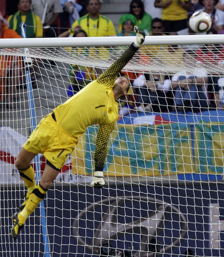 Netherlands goalkeeper Maarten Stekelenburg makes a save during the World Cup quarterfinal soccer match between the Netherlands and Brazil at Nelson Mandela Bay Stadium in Port Elizabeth, South Africa, Friday, July 2, 2010. (AP Photo/Andre Penner)