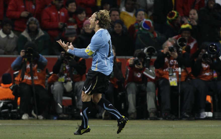 Uruguay's Diego Forlan celebrates after scoring a goal during the World Cup quarterfinal soccer match between Uruguay and Ghana at Soccer City in Johannesburg, South Africa, Friday, July 2, 2010. (AP Photo/Ivan Sekretarev)
