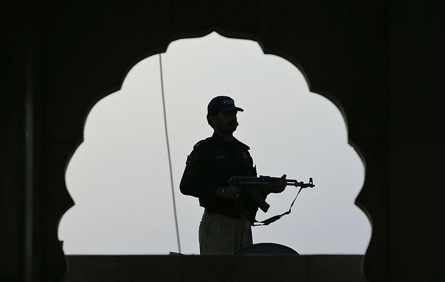 A Pakistani police officer stands guard at the shrine of popular sufi  Data Ganj Baksh in Lahore, Pakistan on Friday, July 2, 2010. Two suicide bombings that killed 42 Thursday night at the popular shrine stirred outrage in this terror-scarred nation Friday. (AP Photo/K.M. Chaudary)