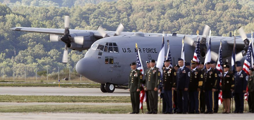 The casket containing the body of the late Sen. Robert C. Byrd arrives aboard a West Virginia Air National Guard C-130 transport plane by an honor guard at Yeager Airport in Charleston, W.Va., Thursday, July 1, 2010. Mr. Byrd will repose at the Capitol until Friday morning when a memorial service will be held.  (AP Photo/Steve Helber)