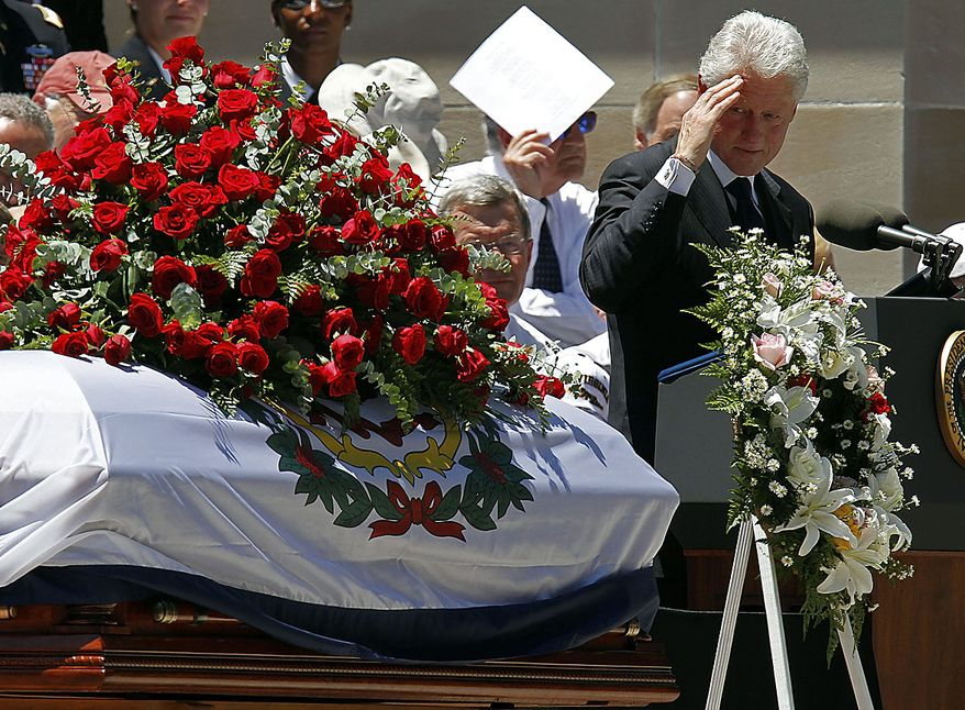 Former President Bill Clinton salutes the casket after his tribute during a memorial service for Sen. Robert Byrd, Friday, July 2, 2010, at the West Virginia State Capitol in Charleston, W.Va. (AP Photo/Steve Helber)