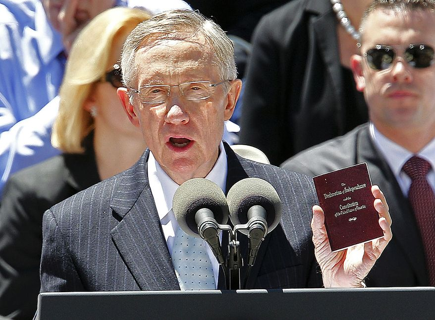 Senate Majority Leader  Harry Reid of Nev. holds up a copy of the Constitution during his tribute at a memorial service for Sen. Robert Byrd, Friday, July 2, 2010, at the West Virginia State Capitol in Charleston, W.Va. (AP Photo/Gene J. Puskar)