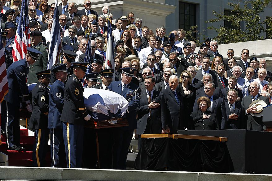 The coffin of Sen. Robert Byrd  is brought down the steps at the Capitol in Charleston, W.Va., Friday, July 2, 2010. (AP Photo/Charles Dharapak)