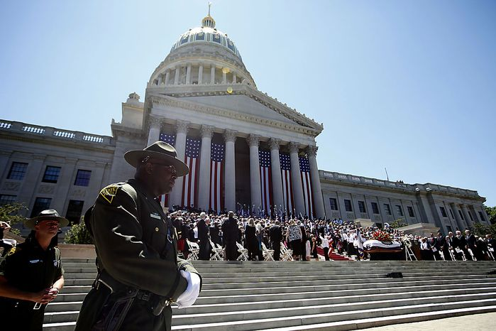 West Virginia State Troopers stand watch as President Barack Obama attends at a memorial service for Sen. Robert Byrd, Friday, July 2, 2010, at the Capitol in Charleston, W.Va. (AP Photo/Charles Dharapak)