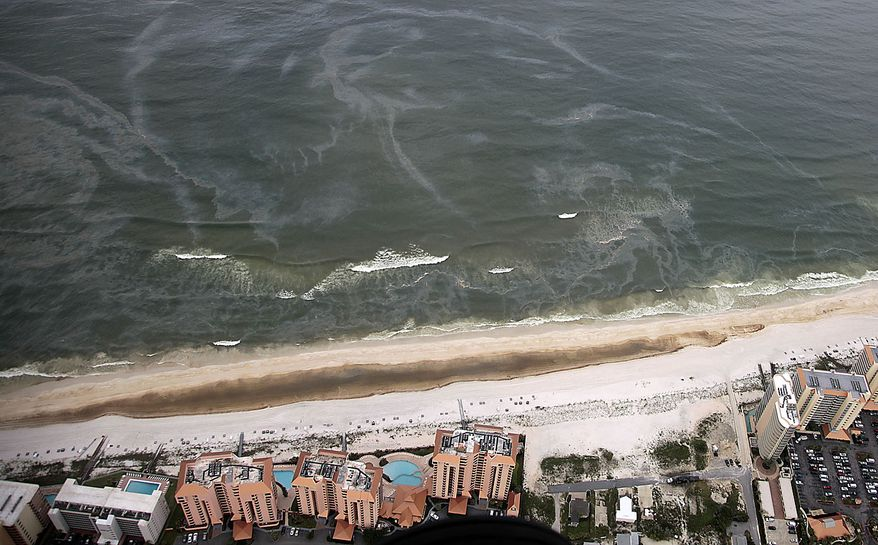 Oil slicks approach the beach in Orange Beach, Ala., Friday, July 2, 2010. Oil from the Deepwater Horizon incident is expected to come ashore over the July 4th weekend. (AP Photo/Dave Martin)