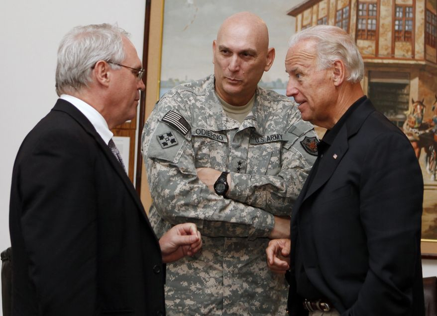 U.S. Vice President Joe Biden, right, Gen. Ray Odierno, center, and U.S. Ambassador to Iraq Christopher Hill, left, confer at the embassy in Baghdad, Iraq, Saturday, July 3, 2010. (AP Photo/Hadi Mizban)