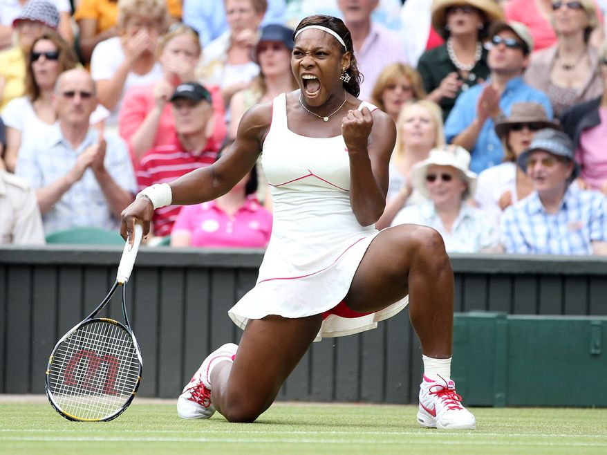 Serena Williams of the United States celebrates a point win over Russia's Vera Zvonareva during their women's singles final at the All England Lawn Tennis Championships at Wimbledon, Saturday, July 3, 2010. (AP Photo/Alastair Grant)