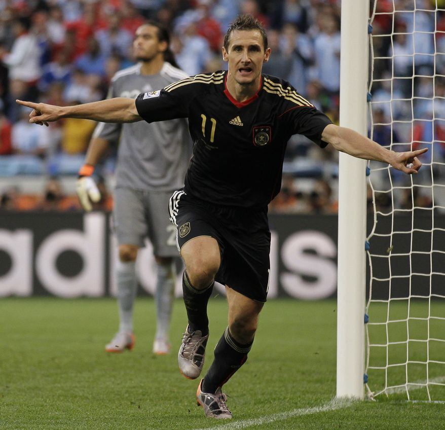 Germany's Miroslav Klose celebrates after scoring the second goal during the World Cup quarterfinal soccer match between Argentina and Germany at the Green Point stadium in Cape Town, South Africa, Saturday, July 3, 2010. (AP Photo/Matt Dunham)
