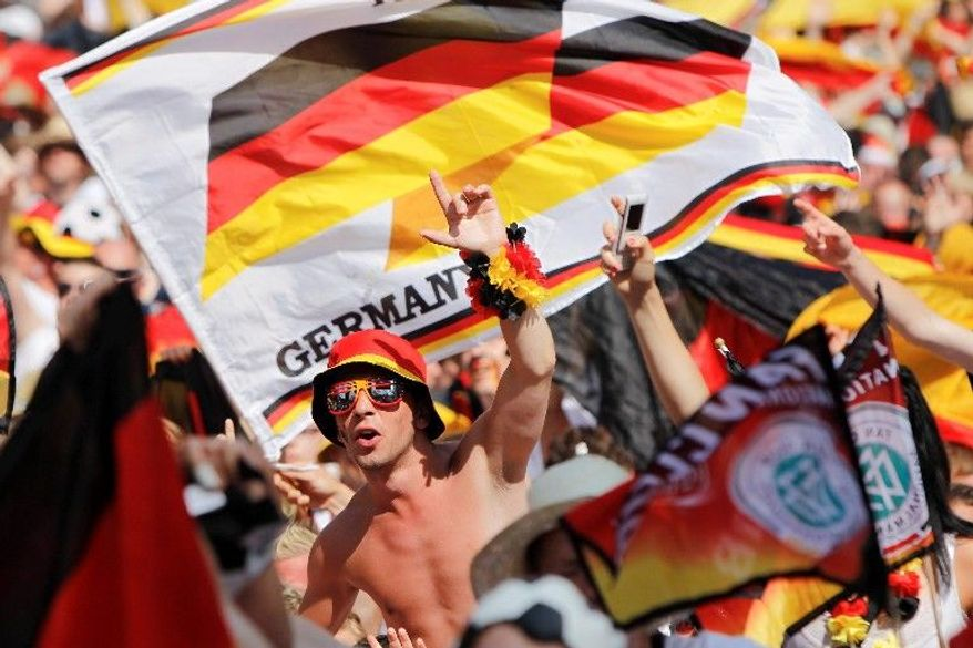 Fans of Germany's soccer team show their pride in Berlin before the quarterfinal World Cup match between Argentina and Germany on Saturday. (Associated Press)