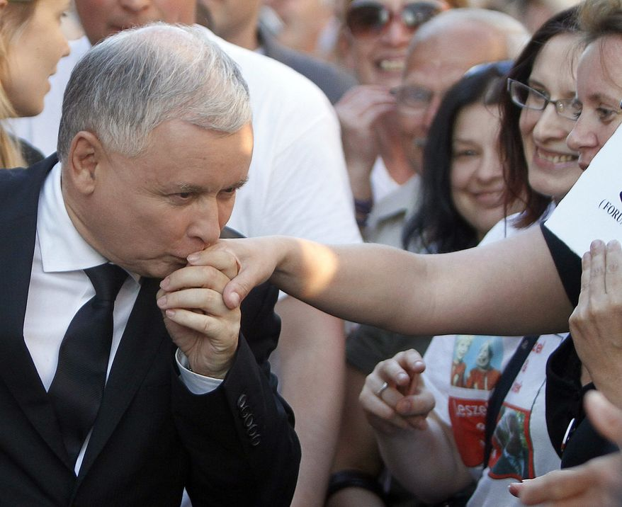 Jaroslaw Kaczynski, presidential candidate of the conservative Law and Justice party and twin brother of the late President Lech Kaczynski killed in a plane crash, meets supporters prior to a pre election rally in Warsaw, Poland, Friday, July 2, 2010. (AP Photo/Czarek Sokolowski)