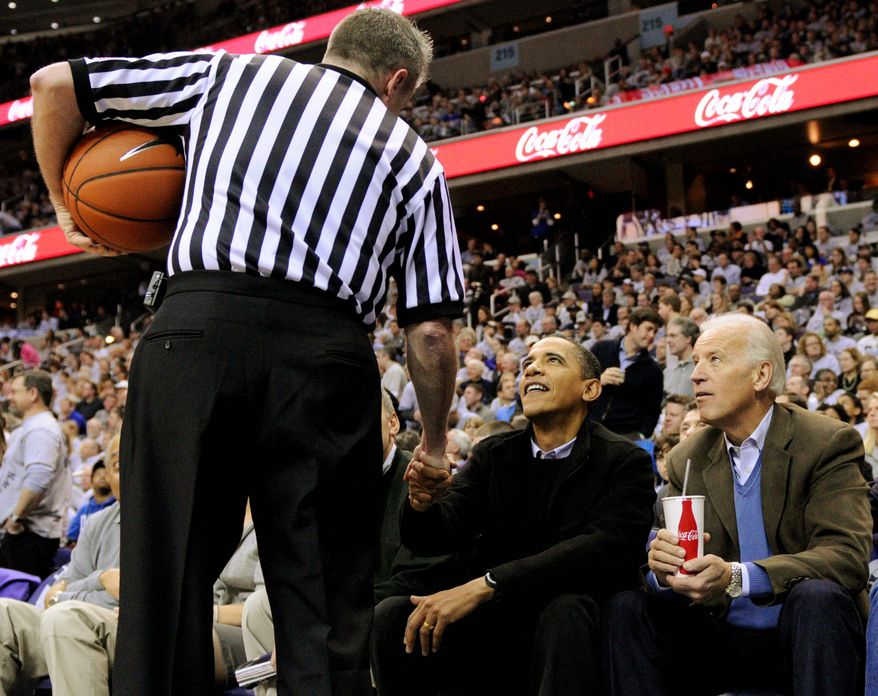 **FILE** President Obama attended the Duke-Georgetown NCAA game on Jan. 30, 2010 with Vice President Joseph R. Biden Jr. (Associated Press)