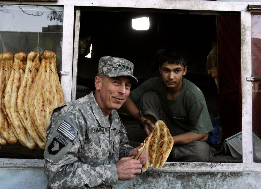 """Gen. David H. Petraeus, the new commander of U.S. and NATO forces in Afghanistan, grabs a bite at a bakery in Kabul, Afghanistan. President Obama said about Gen. Petraeus, """"I'm extraordinarily grateful that he has agreed to serve in this new capacity."""" (Associated Press)"""