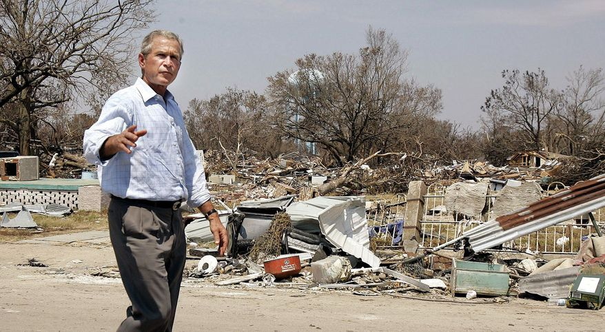 DEJA-VU: President Bush takes a walking tour of a Biloxi, Miss., neighborhood devastated by Hurricane Katrina in a visit in September 2005. (Associated Press)