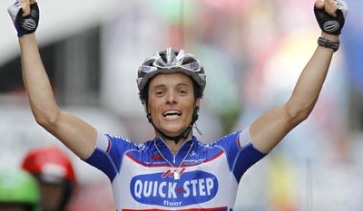 Sylvain Chavanel of France crosses the finish line to win the second stage of the Tour de France cycling race over 125 miles with start in Brussels and finish in Spa, Belgium, Monday July 5, 2010. (AP Photo/Laurent Rebours)