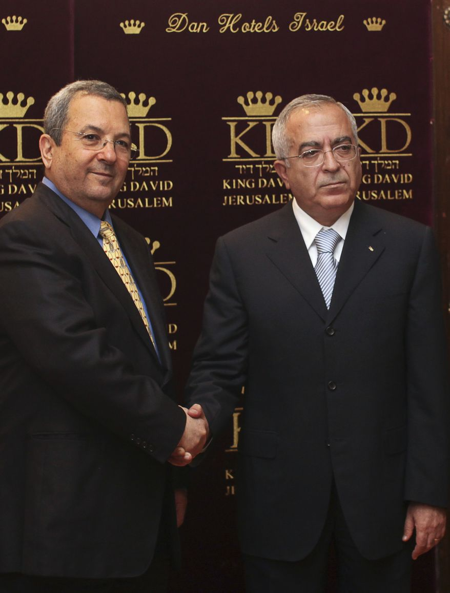 Israeli Defense Minister Ehud Barak, left, shakes hands with Palestinian Prime Minister Salam Fayyad before their meeting in Jerusalem, Monday, July 5, 2010. Israel on Monday redefined the rules of its Gaza Strip embargo, spelling out on the eve of Prime Minister Benjamin Netanyahu's White House visit what will be restricted from entering the territory under a much-eased land blockade. (AP Photo/Tara Todras-Whitehill)