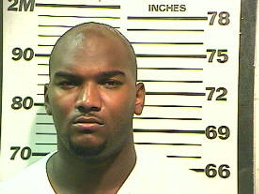 In this photo released by Mobile (Ala.) County Sheriff's Office shows JaMarcus Russell on Monday in Mobile, Ala. Mobile County Sheriff's spokeswoman Lori Myles said the 24-year-old football player was arrested Monday at his home during an undercover investigation. He is charged with possession of a controlled substance. (Associated Press)