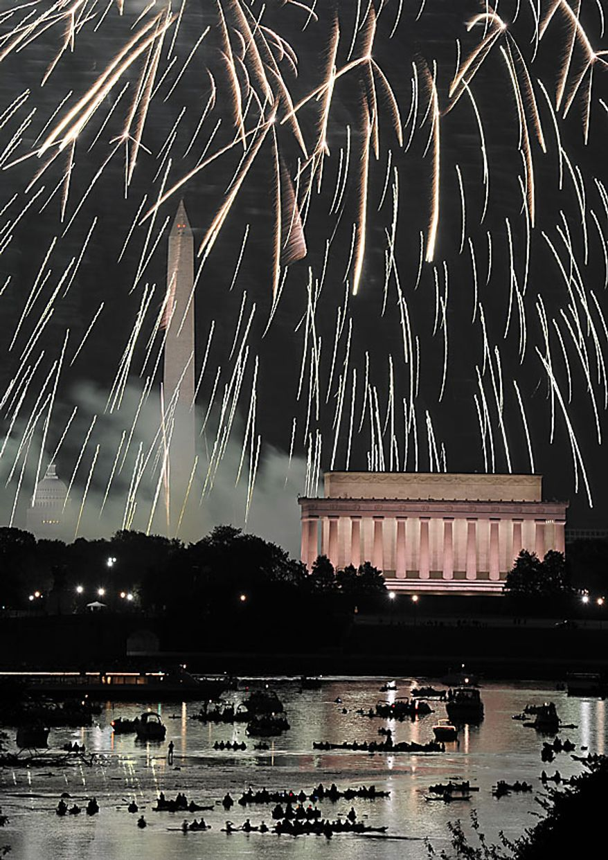 Fireworks explode over Washington as the United States celebrates its 234th birthday,  Sunday, July 4, 2010. Seen from left is the U.S. Capitol, Washington Monument and Lincoln Memorial. (AP Photo/Cliff Owen)