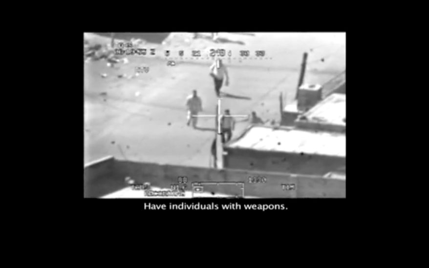 This frame grab image taken from a video shot from a U.S. army Apache helicopter gun-sight, posted at Wikileaks.org and confirmed as authentic by a senior U.S. military official, shows a group of men in the streets of the New Baghdad district of eastern Baghdad just prior to being fired upon by the helicopter July 12, 2007. In a series of online chats Spc. Bradley Manning told of leaking classified diplomatic reports, along with this secret video, to the whistleblower website Wikileaks.org. (AP Photo/Wikileaks.org)